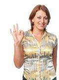 Het meisje toont een teken stock afbeeldingen