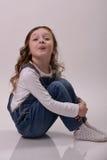 Het meisje toont haar toungue Stock Afbeelding