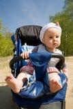 Het meisje van de baby in de wandelwagen Stock Foto's