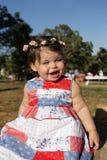 Het meisje van de baby in een kleding Stock Afbeelding