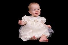 Het meisje van de baby in een witte kleding Royalty-vrije Stock Afbeeldingen