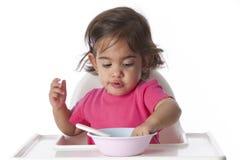 Het meisje van de baby eet met haar hand Royalty-vrije Stock Afbeeldingen