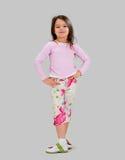 Het meisje van de baby in helder gekleurde kleren royalty-vrije stock fotografie