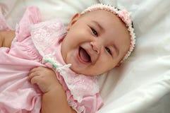 Het Meisje van de baby in het Roze Lachen Stock Afbeeldingen