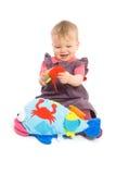 Het meisje van de baby het spelen met geïsoleerdi stuk speelgoed - Stock Afbeeldingen