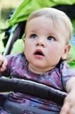 Het meisje van de baby in kinderwagen Stock Afbeelding