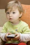 Het meisje van de baby met afstandsbediening royalty-vrije stock afbeelding