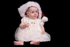 Het meisje van de baby met de hoed van de Kerstman Royalty-vrije Stock Afbeelding