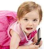 Het Meisje van de baby met de Telefoon van de Cel stock afbeeldingen