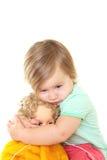 Het meisje van de baby met haar pop Stock Afbeelding