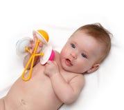 Het meisje van de baby met rammelaar Stock Afbeeldingen