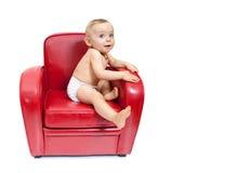 Het meisje van de baby op een leunstoel. Stock Fotografie