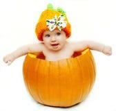 Het meisje van de baby in pompoen Stock Foto's