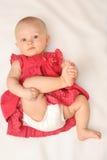 Het meisje van de baby in rode kleding Stock Foto's