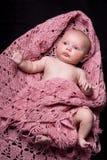 Het Meisje van de baby in Roze Wollen Sjaal stock foto