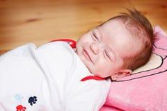 Het meisje van de baby slaap en het dromen Stock Foto