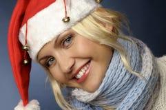 Het meisje van de blonde binnen en santahoed Stock Afbeeldingen