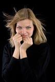 Het meisje van de blonde in een zwarte col royalty-vrije stock foto
