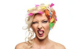 Het meisje van de blonde met veren Stock Foto's