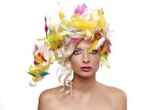 Het meisje van de blonde met veren Royalty-vrije Stock Foto's