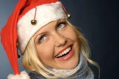Het meisje van de blonde in santahoed Stock Fotografie