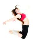 Het meisje van de geschiktheid het springen stock afbeelding