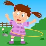 Het Meisje van de Hoepel van Hula in het Park Royalty-vrije Stock Afbeelding