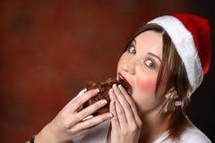 Het meisje van de kerstman met cake Stock Foto