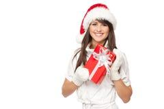 Het meisje van de kerstman met gift Stock Afbeelding