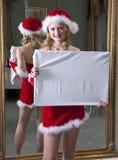 Het meisje van de kerstman met raad Royalty-vrije Stock Afbeeldingen