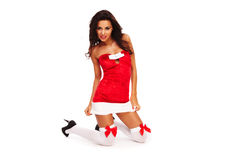 Het meisje van de kerstmanhelper op witte achtergrond met lang haar Royalty-vrije Stock Foto