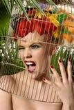 Het meisje van de papegaai Stock Foto's