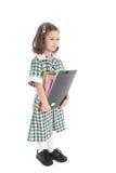 Het meisje van de school in eenvormig met boeken Stock Foto's