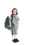Het meisje van de school in eenvormig met zak Stock Afbeeldingen