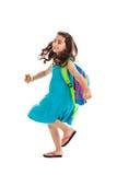 Het meisje van de school lopen geïsoleerda op wit Royalty-vrije Stock Afbeeldingen