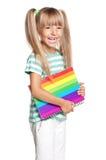 Het meisje van de school met boeken royalty-vrije stock afbeeldingen