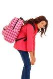 Het meisje van de school met te zware rugzak Stock Fotografie