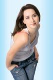 Het meisje van de schoonheid in jeans stock foto