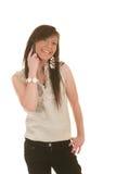 Het meisje van de tiener bij cellphone het lachen Stock Foto's
