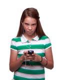 Het meisje van de tiener het een lijst maken van aan muziek Royalty-vrije Stock Foto