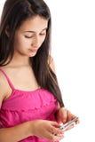 Het meisje van de tiener het texting Stock Afbeeldingen