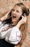 Het meisje van de tiener in hoofdtelefoons Royalty-vrije Stock Foto