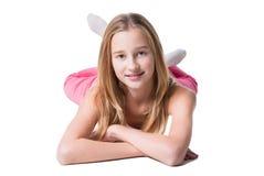 Het meisje van de tiener leggen geïsoleerdo op wit Royalty-vrije Stock Afbeelding