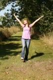 Het meisje van de tiener in zonneschijn stock foto's