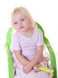 Het meisje van de zitting treurt Stock Foto