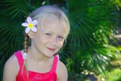 Het meisje van Frangipani Stock Afbeeldingen