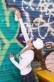 Het meisje van Graffitti stock fotografie