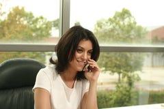 Het meisje van het bureau Stock Foto