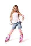 Het meisje van het de schaatserkind van de rol op de rollen. Stock Afbeeldingen