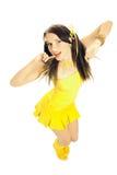 Het meisje van het geslacht in een gele kleding Royalty-vrije Stock Afbeeldingen